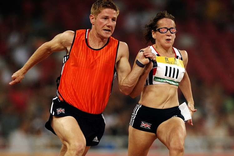 Blind sprinter Tracey Hinton competes while tethered to her guide, Steffan Hughes, in a 2008 race in Beijing. The pair will run together during the Paralympic Games which began Wednesday in London. ACTION IMAGES/ZUMA PRESS